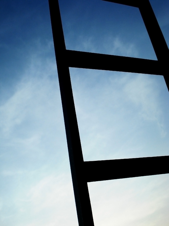 Ladder going up with a sky background